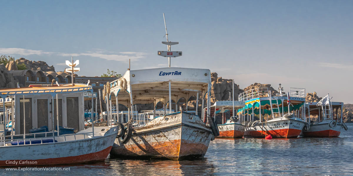 colorful motor boats for ferrying tourist to Philae Temple
