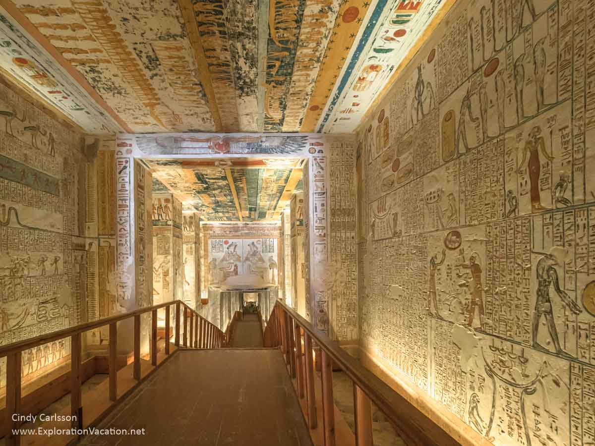 Decorated yellow hall leading into the depth of a tomb