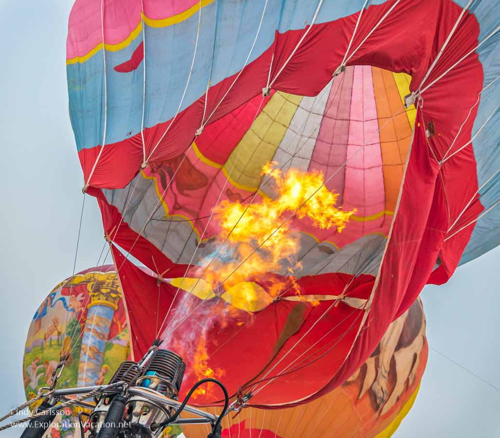 flames shoot up into a hot air balloon