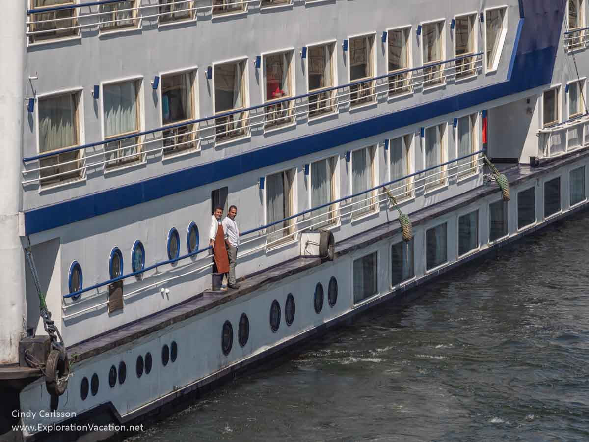 portion of a Nile river cruise ship with crew outside