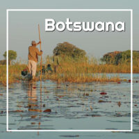 "Traveling through a wetland in a wooden boat with text ""Botswana"""
