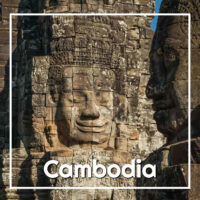 "Carved face at Angkor Wat with text ""Cambodia"""