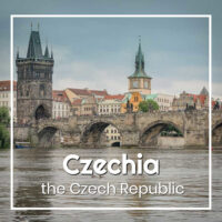 "Stone bridge and towers in Prague with text ""Czechia - the Czech Republic"""