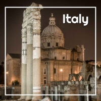 "Roman forum at night with text ""Italy"""