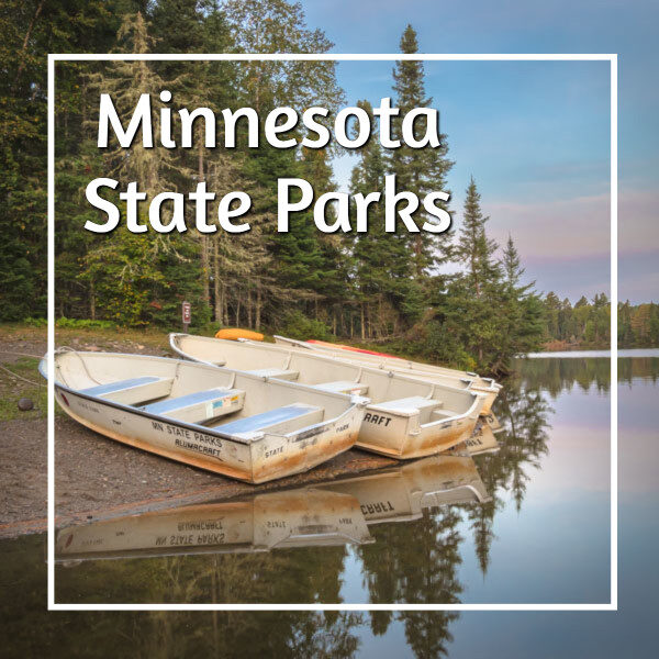 "small boats on a lake shore with text ""Minnesota State Parks"""