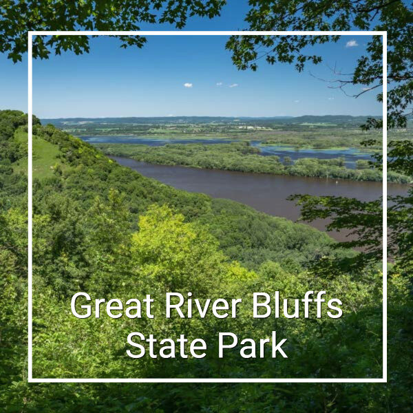 """View over river bottoms from a hill and text """"Great River Bluffs State Park"""""""
