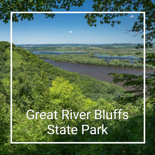 "View over river bottoms from a hill and text ""Great River Bluffs State Park"""