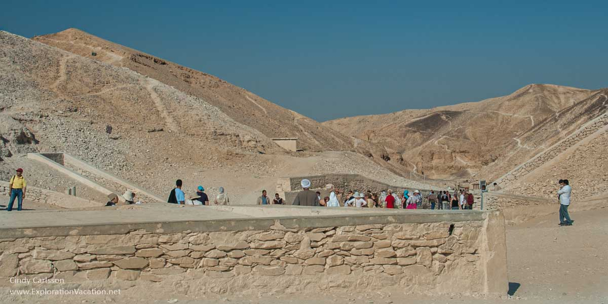 overview of valley of the kings with tourists