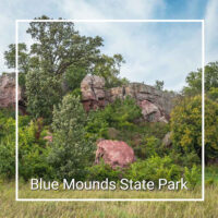"purple quartzite cliffs with trees and text ""Blue Mounds State Park"""