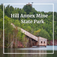 "mining elevator above water with text ""Hill Annex Mine State Park"""