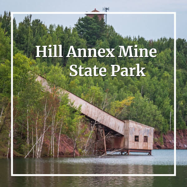 """mining elevator above water with text """"Hill Annex Mine State Park"""""""