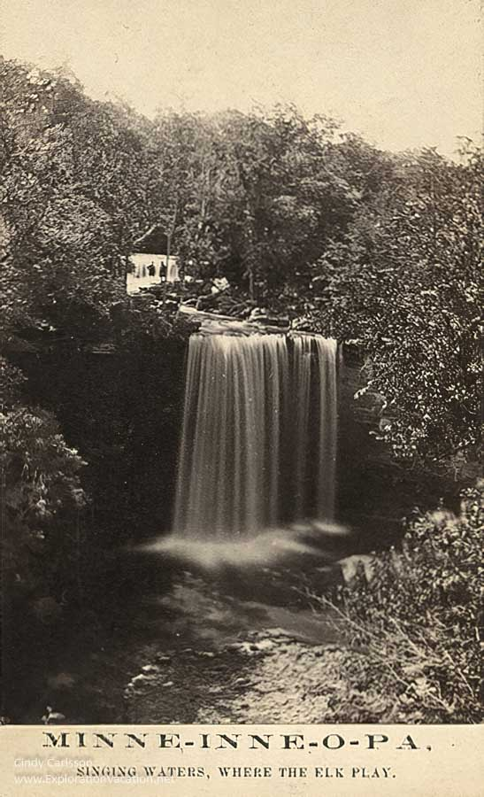 "postcard with a double waterfall and text ""Minneinneopa Park Hotel: Singing waters, where the elk play"""