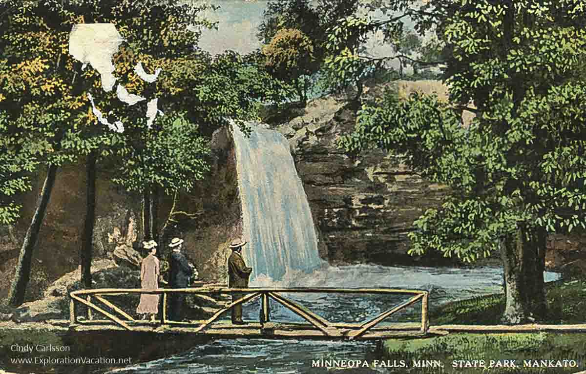 1915 postcard with bridge and people standing looking at a waterfall