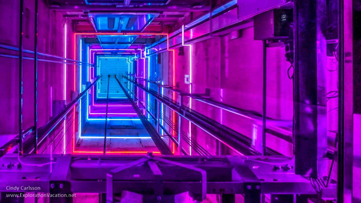 bright colored lights above an elevator car