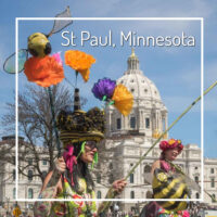 "state capital with street performer and text ""St Paul, Minnesota"""