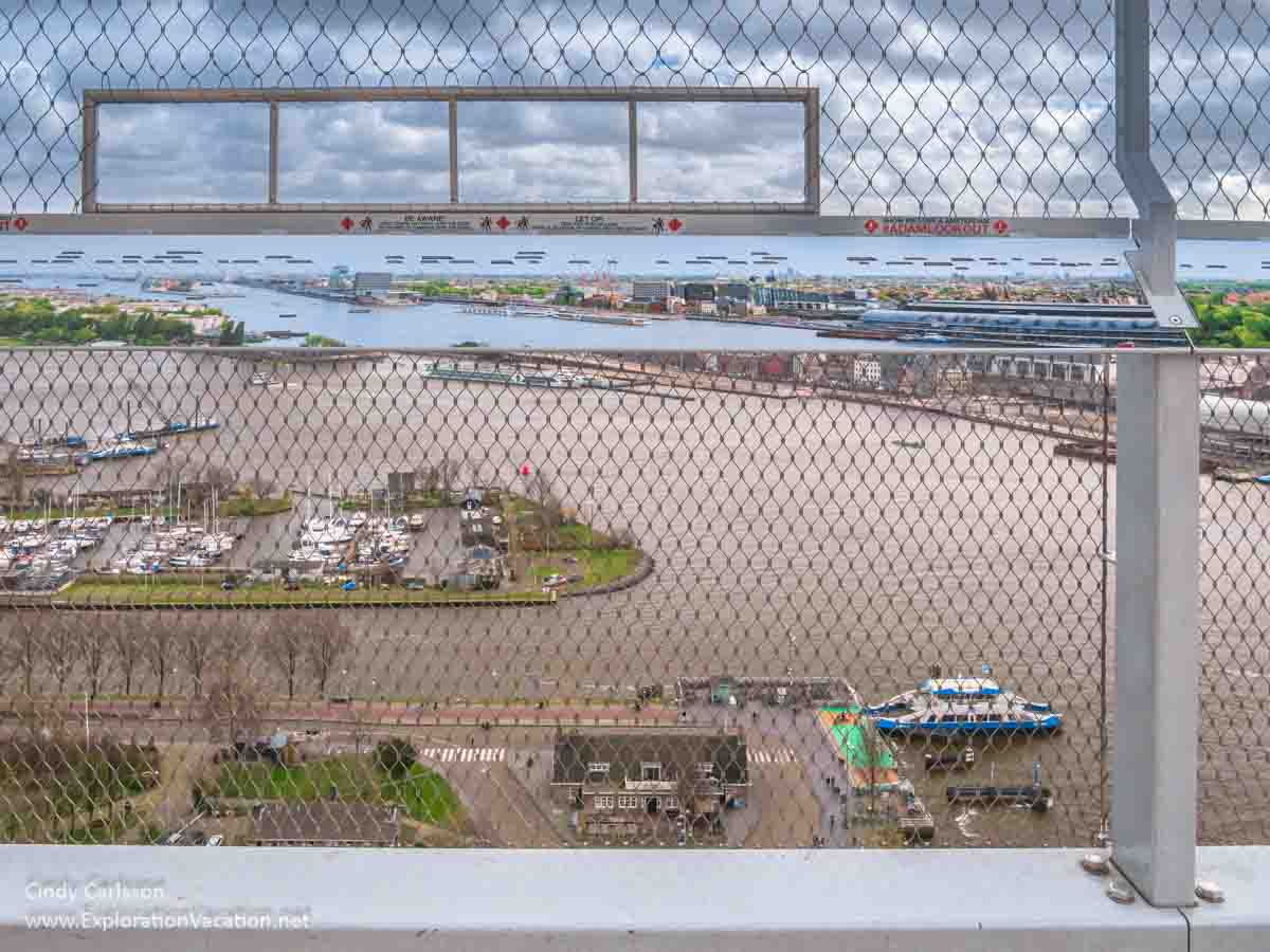 view of a riverfront from above through a fence