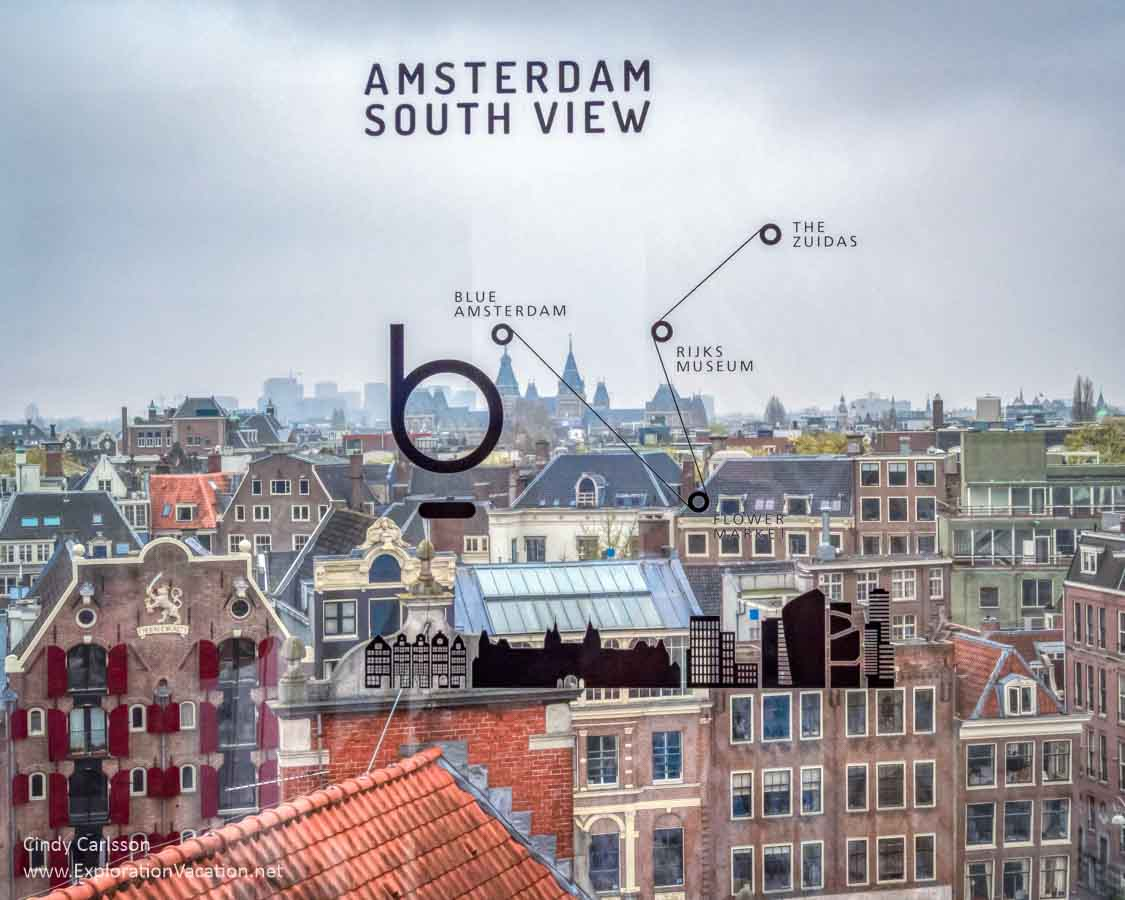 view out a window at the rooftops of Amsterdam with text