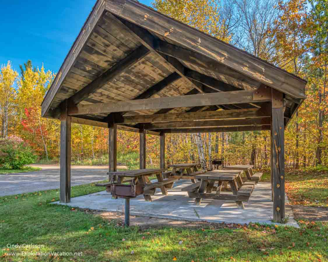 picnic tables under a wooden shelter