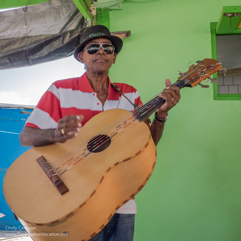 man with an over-sized guitar