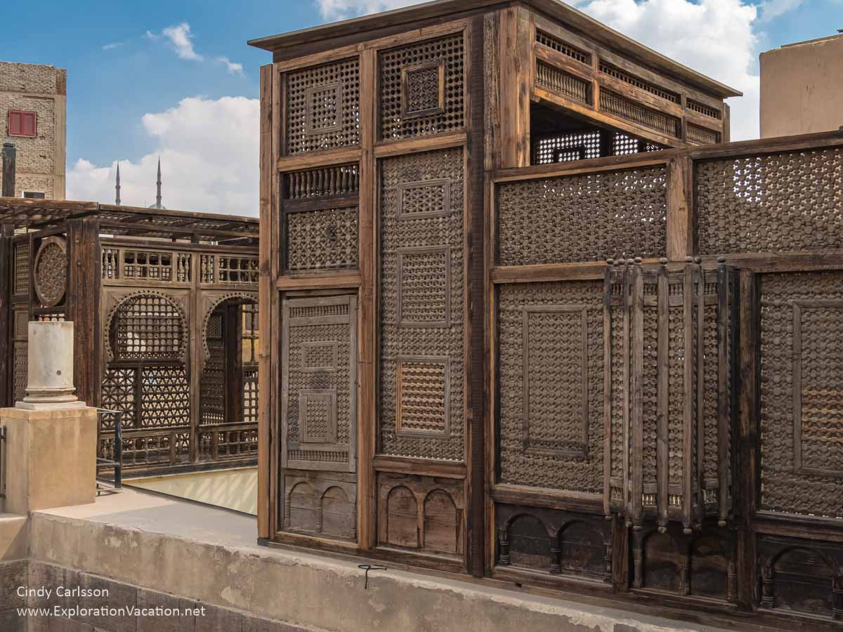 wood screens provide privacy on a Cairo rooftop