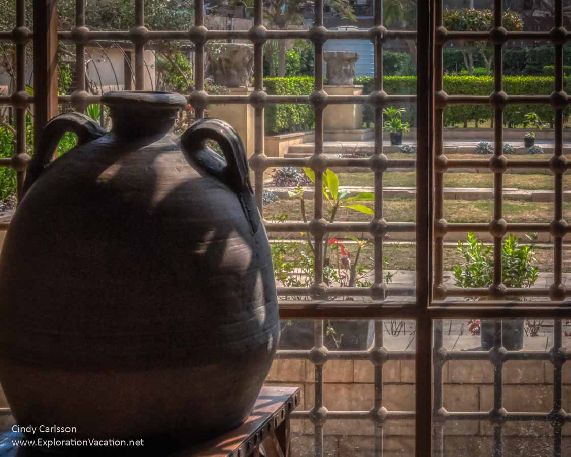 water jug by a screen with view of a garden in Cairo
