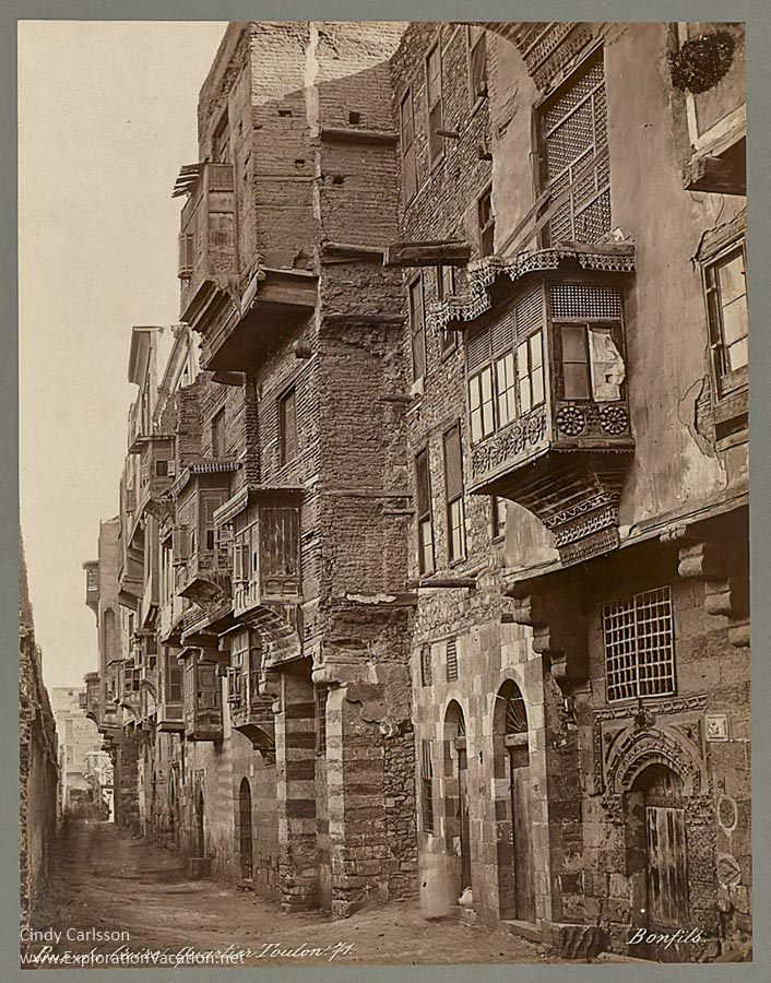 old photo of a street of houses in Cairo