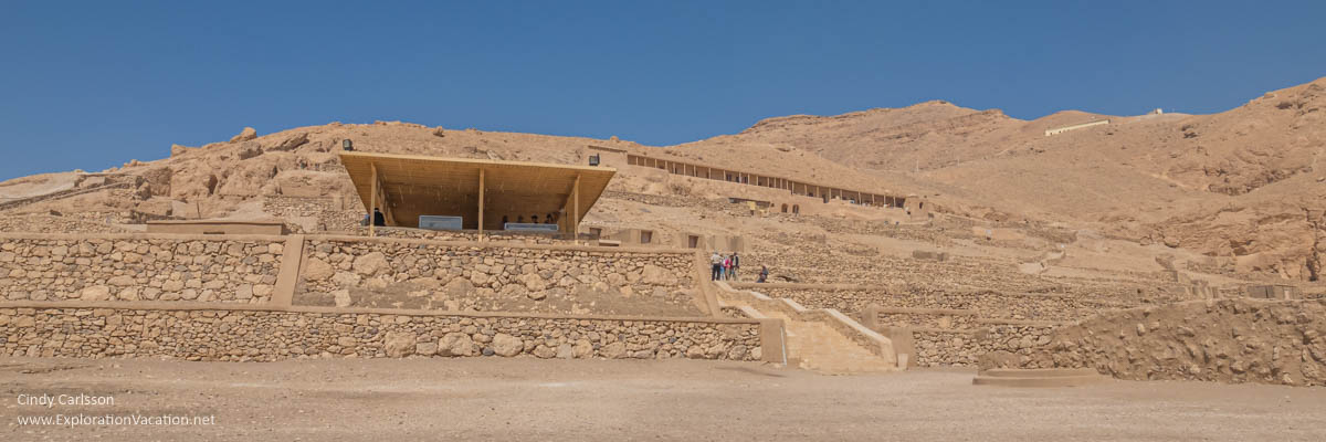 panorama of a hillside with tombs and covered patios