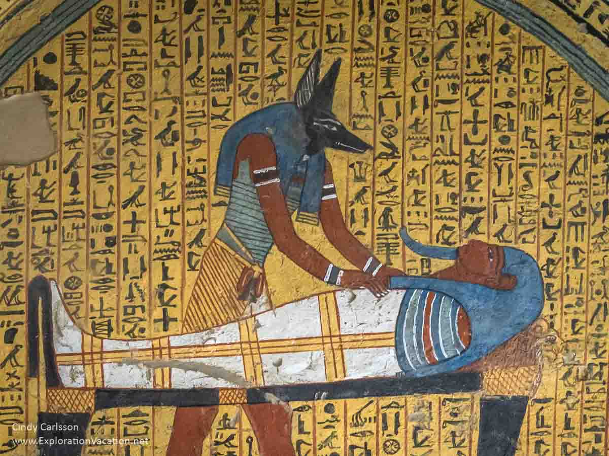 painting of Anubis tending to the mummy of Amennakht in an Egyptian tomb