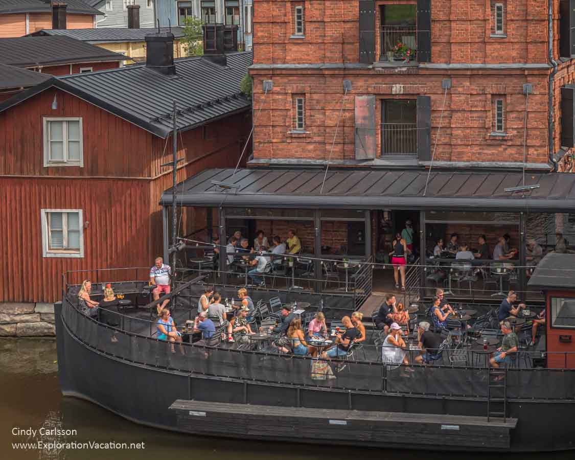 people eating on a boat used as a bar