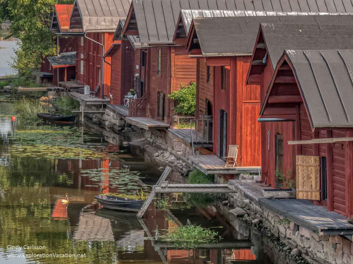 old red Scandinavian buildings along a river