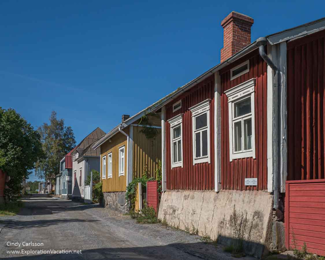 row of brightly colored old wood houses
