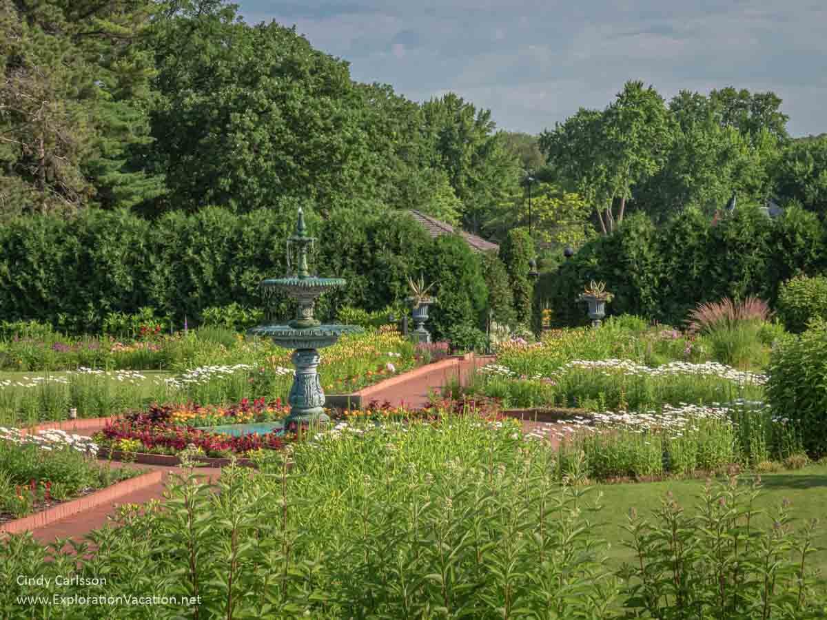 formal garden with a fountain in Clemens Garden