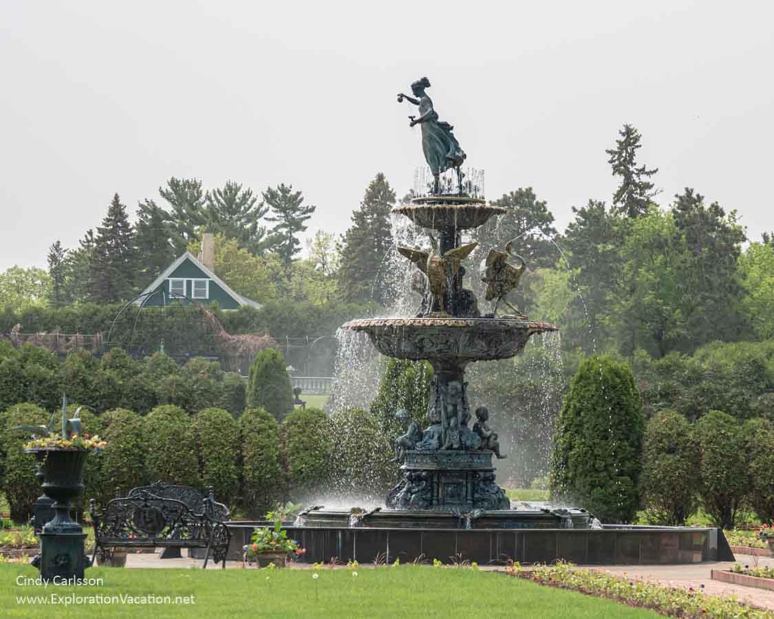 A tall fountain in a garden