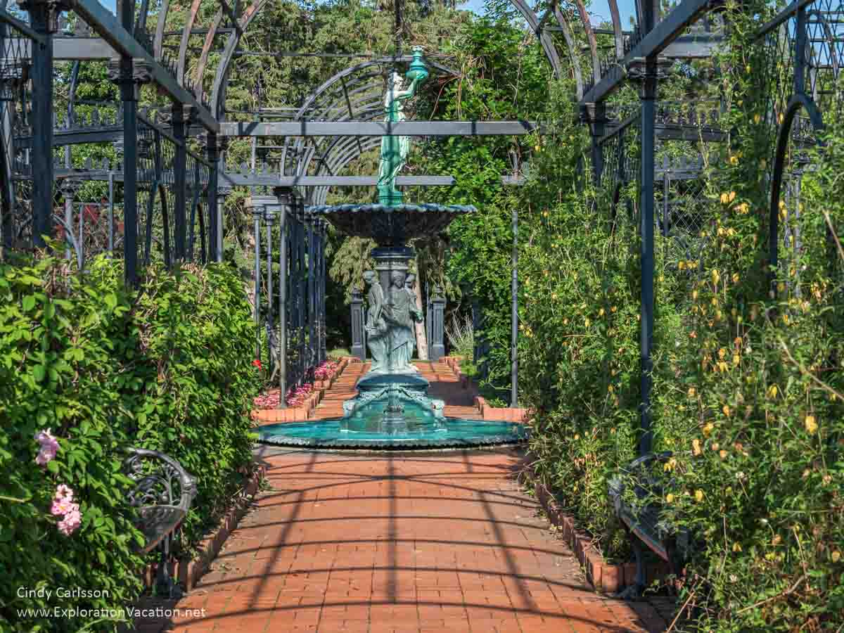 large metal arbor with fountain