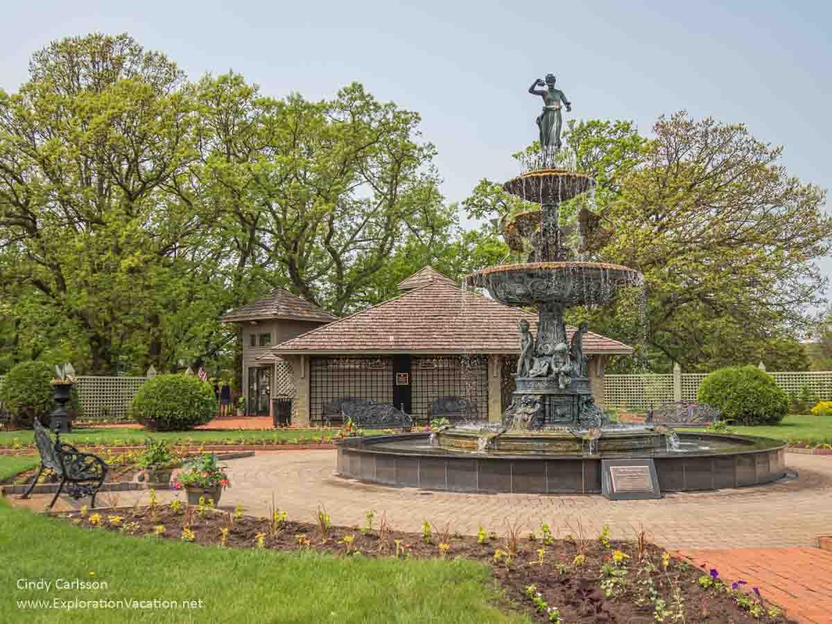 fountain outside a building in a garden