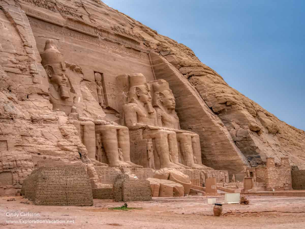 photo of monumental statues outside an Egyptian temple