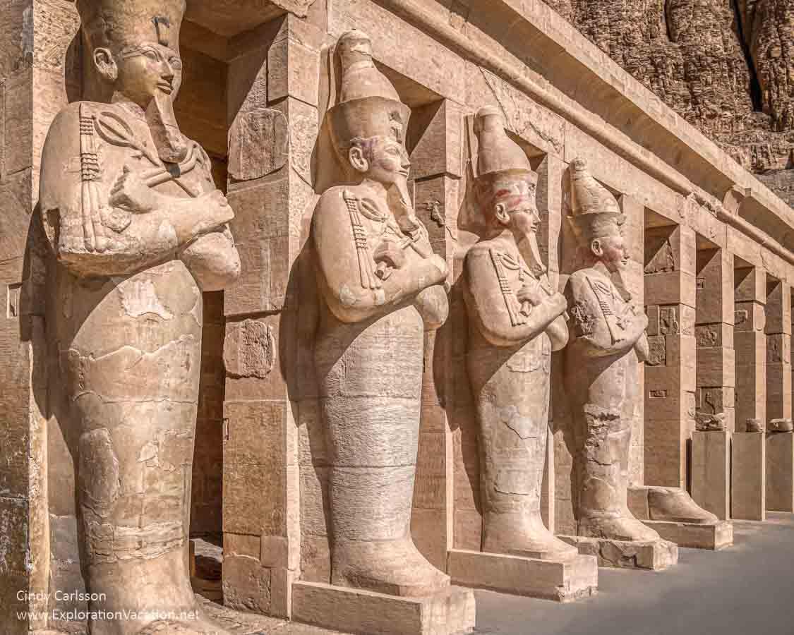 photo of monumental sculptures of an Egyptian pharo