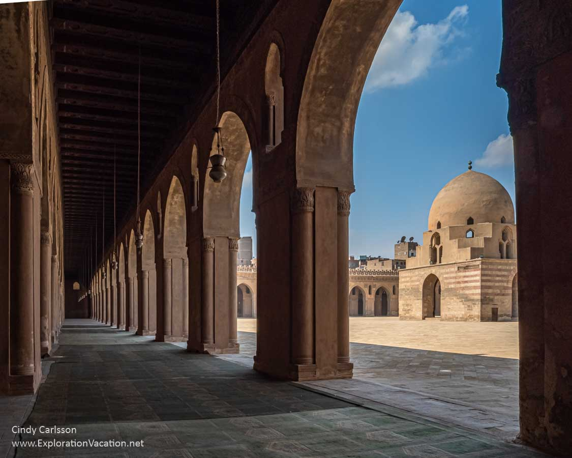 photo of an old mosque viewed through an arch