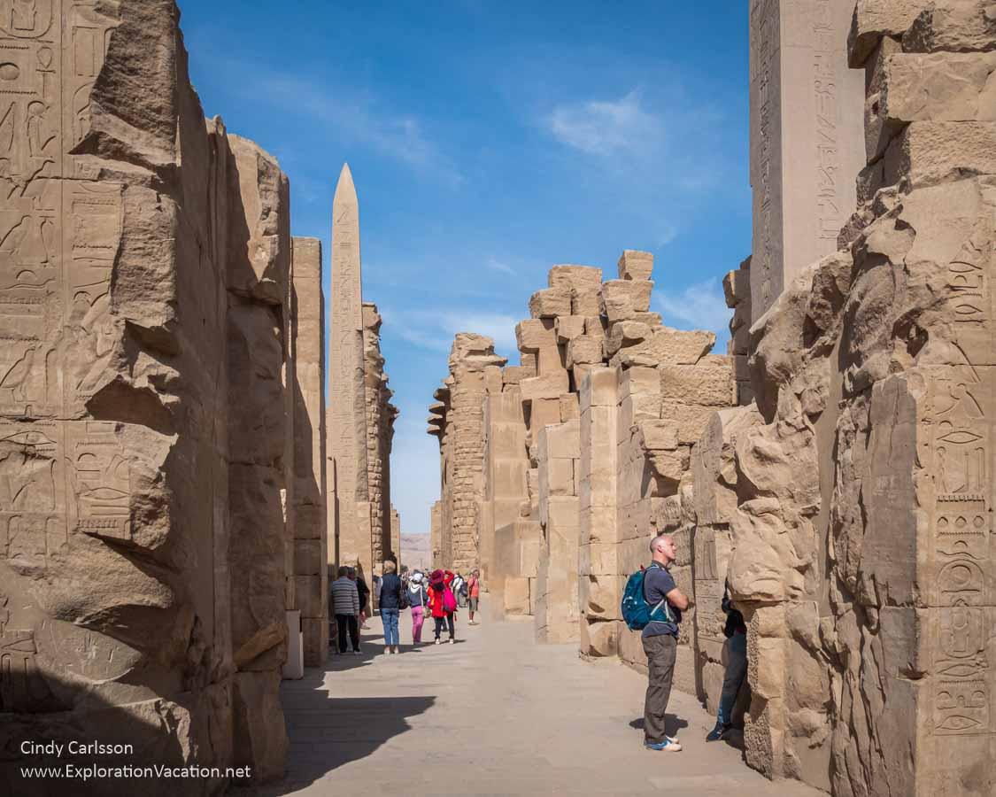 photo of Karnak Temple ruins with obelisk