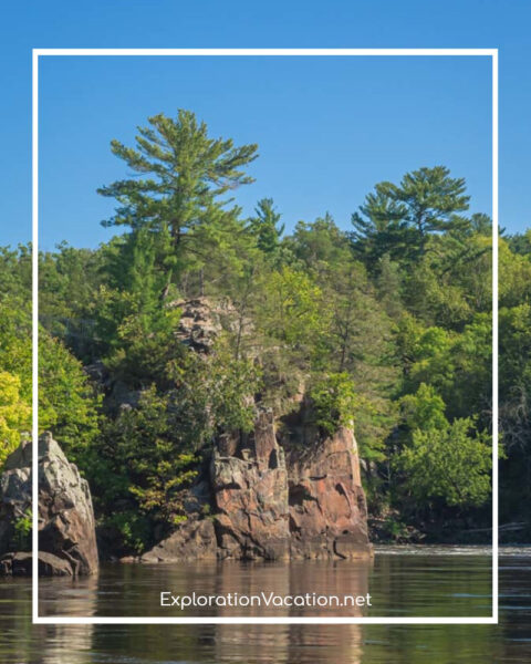 forested cliffs along a river