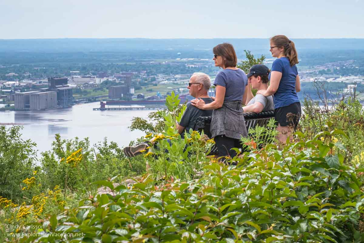 A family takes in the view of Duluth from above
