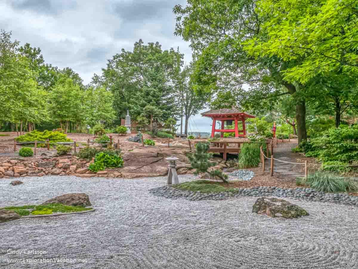 Japanese rock zen garden with bell tower in background