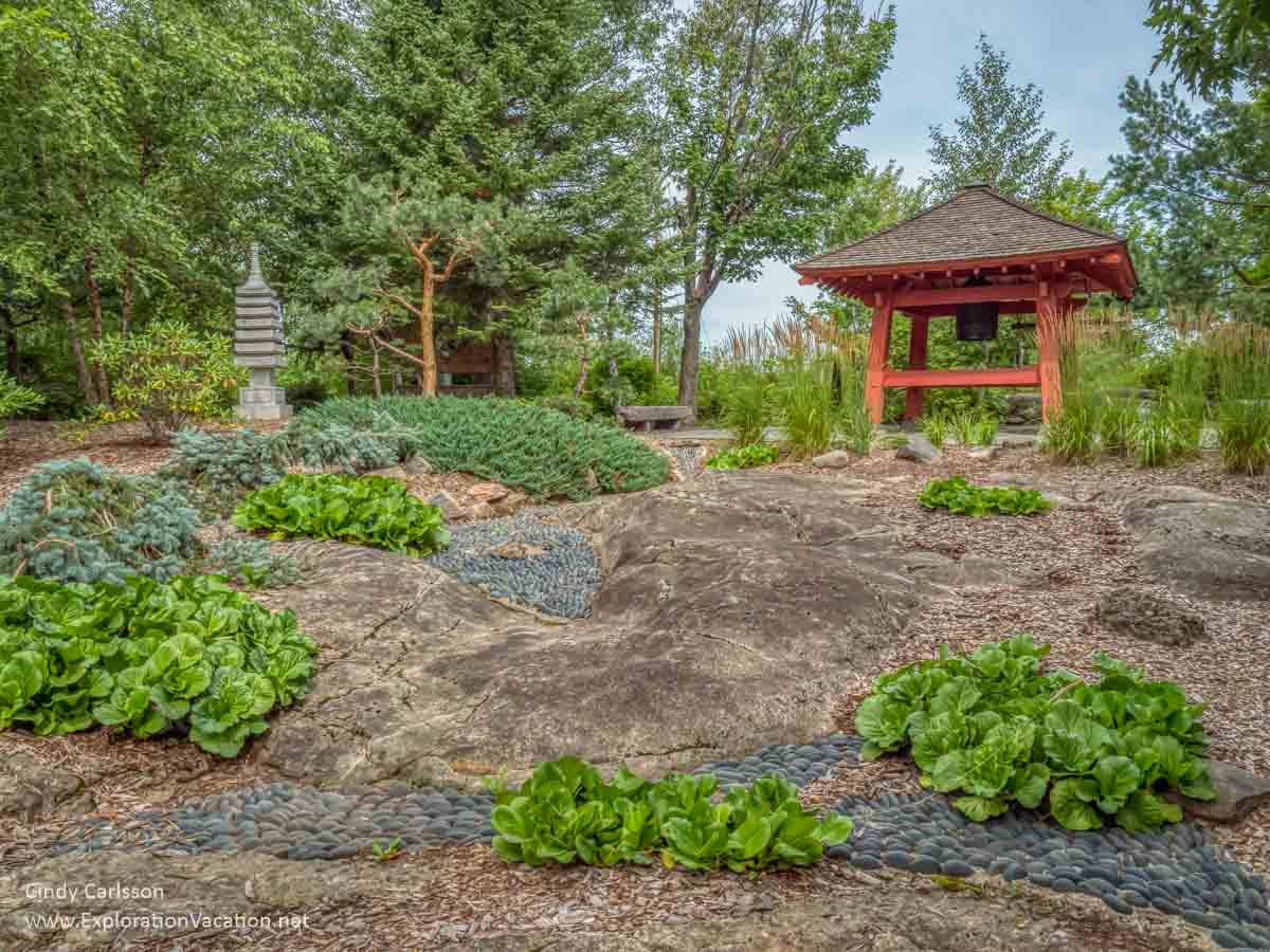 Japanese garden with rocks and bell tower