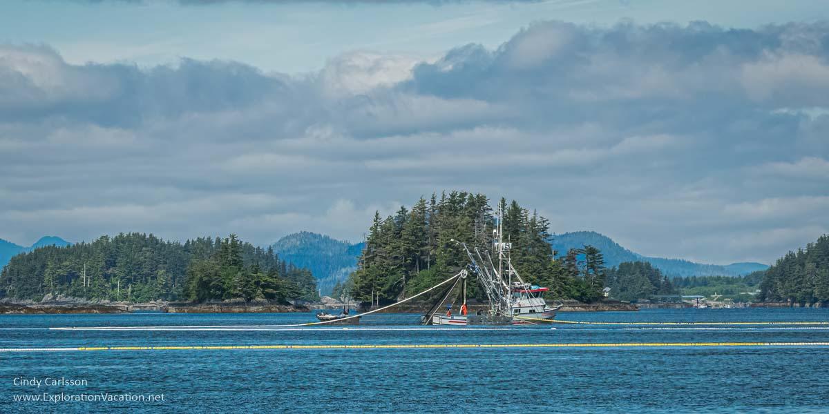 Purse seiner boat, tender, and net in Sitka Sound Alaska