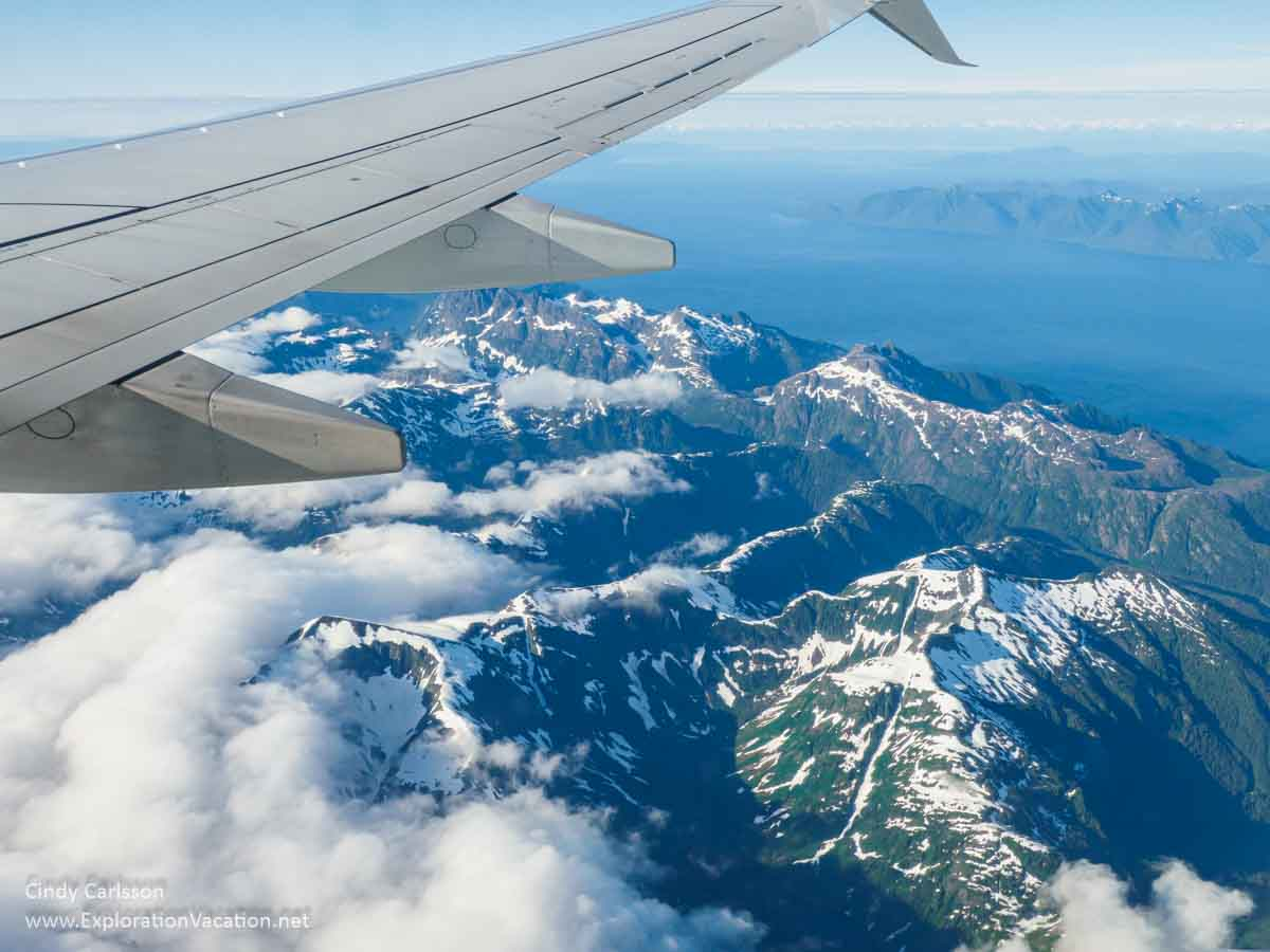 airplane wing with mountains below