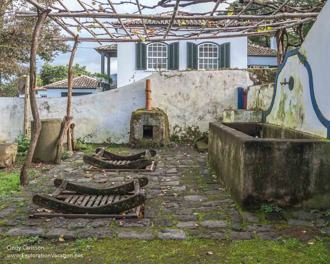 antique wine-making equipment in a courtyard in the Azores