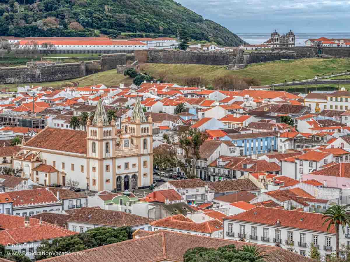 historic colonial era buildings in Angra do Heroismo with fortress in the background